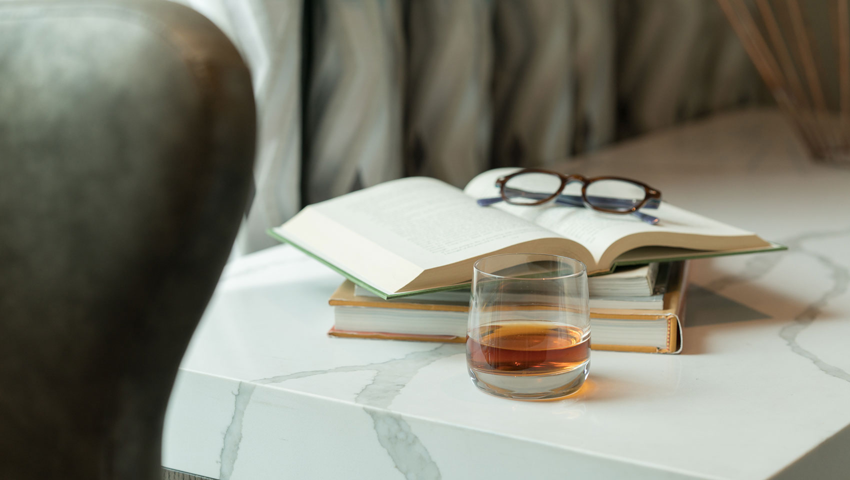 whiskey and glasses on a table