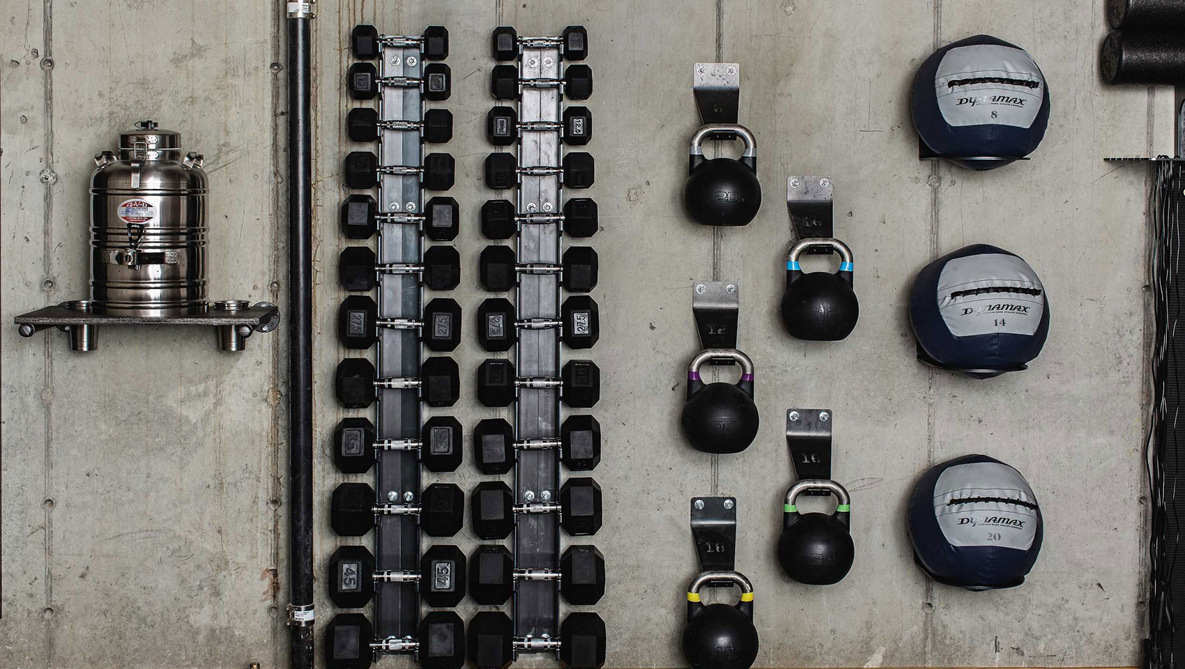 gym weights against a wall