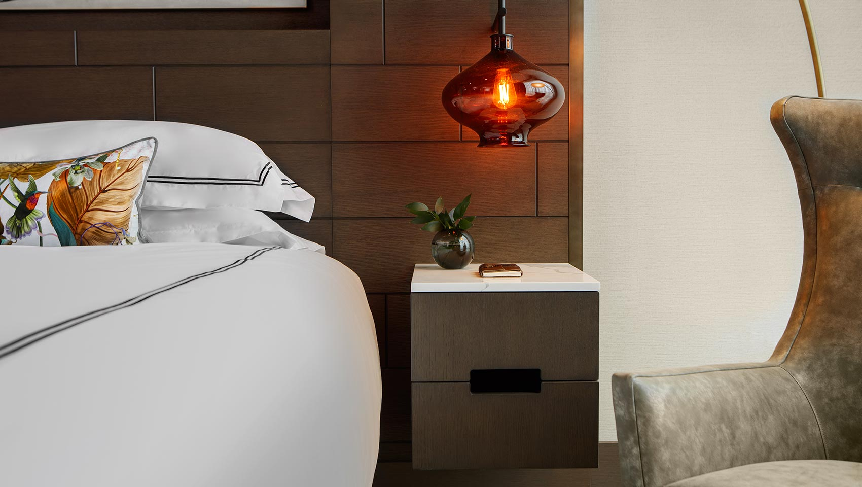hotel bed pillow and side lamp