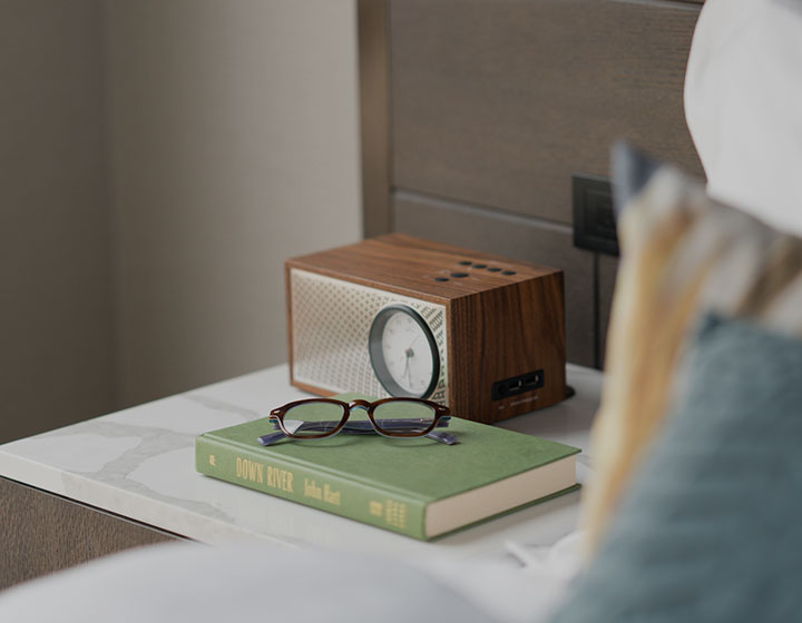 books and glasses on hotel side table