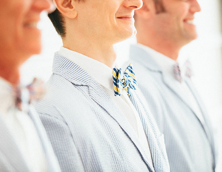 man smiling in bow tie