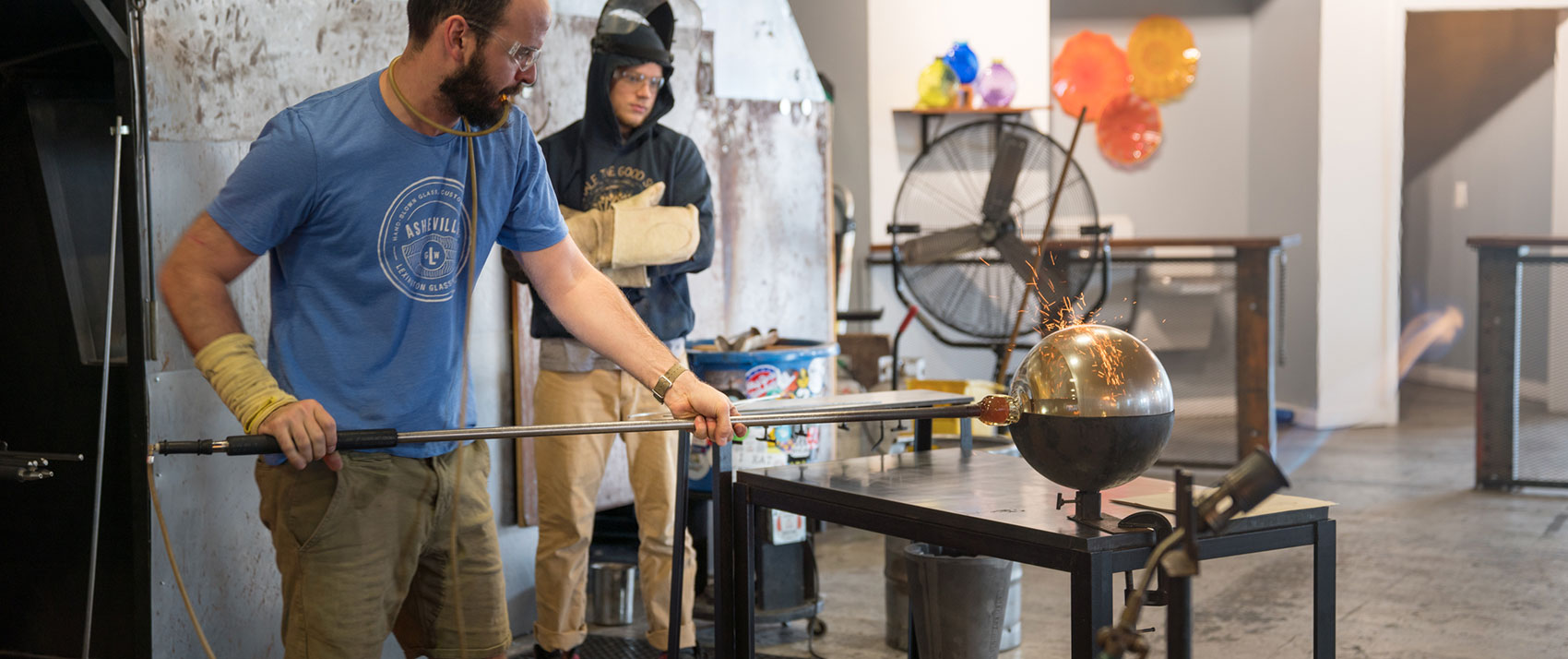 artist blowing glass
